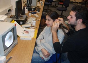 Myself demonstrating video otoscopy to a student
